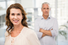 Smiling casual businesswoman in front of her colleague Royalty Free Stock Photos