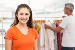 Smiling casual businesswoman volunteering Royalty Free Stock Image