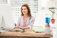Smiling casual businesswoman working with computer Royalty Free Stock Photo