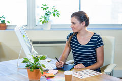 Smiling casual businesswoman working on digitizer Royalty Free Stock Photo