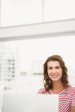 Smiling casual businesswoman working with laptop Royalty Free Stock Photography