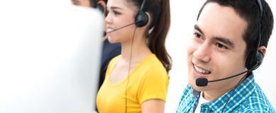 Smiling casual call center team. Panoramic banner stock image