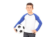 Smiling casual child holding a football Royalty Free Stock Photos