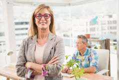 Smiling casual designer in front of her working colleague Royalty Free Stock Image