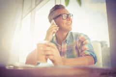 Smiling casual designer having a phone call Royalty Free Stock Image