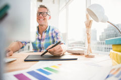 Smiling casual designer using computer and digitizer Stock Images