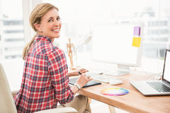 Smiling casual designer using computer and digitizer Royalty Free Stock Photos