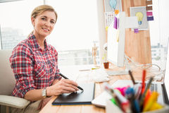 Smiling casual designer working with digitizer Stock Photos