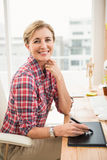 Smiling casual designer working with digitizer Stock Photo