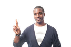 Smiling casual dressed black man gesturing with finger. Stock Photo