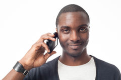 Smiling casual dressed black man at the phone. Royalty Free Stock Photos