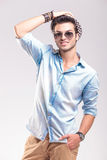 Smiling casual fashion man fixing his hat Royalty Free Stock Photo