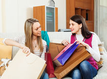 Smiling casual  girls together looking purchases Stock Photo