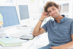 Smiling casual man in a bright office Stock Photo