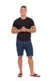Smiling Casual Man In Jeans Shorts And Black Shirt Stock Photos