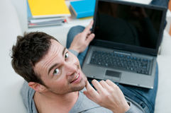 Smiling casual man on laptop Stock Photography