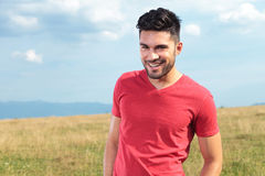 Smiling casual man looking at you Stock Image