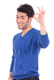 Smiling casual man making the ok hand gesture Royalty Free Stock Images