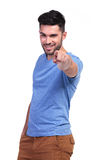 Smiling casual man pointing his finger to the camera Stock Photography