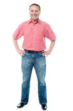 Smiling casual man posing confidently Royalty Free Stock Photo