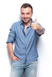 Smiling casual man shows thumb up Royalty Free Stock Image