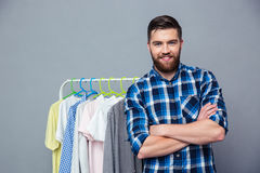 Smiling casual man standing with arms folded Stock Photo