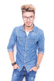 Smiling casual man wearing glasses standing with hands in pocket Stock Photo