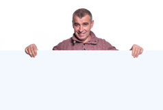 Smiling casual old man holding a big blank board Royalty Free Stock Image