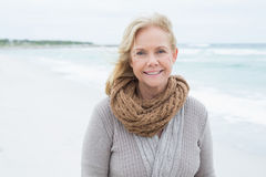 Smiling casual senior woman relaxing at beach Royalty Free Stock Photography
