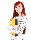 Smiling casual student girl keeping books Royalty Free Stock Photo