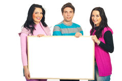 Smiling casual team holding banner Royalty Free Stock Image