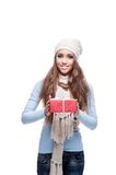 Smiling casual winter girl holding christmas gift Stock Images