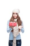 Smiling casual winter girl holding christmas gift Royalty Free Stock Photos