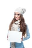 Smiling casual winter girl holding sign Stock Photos