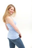 Smiling casual woman looking over her shoulder Stock Photos