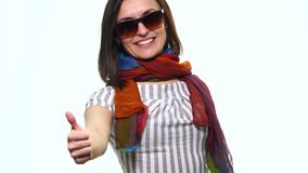 Smiling casual woman pointing finger away isolated on a white background stock video
