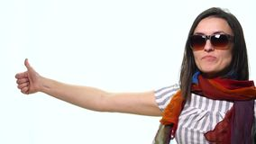 Smiling casual woman pointing finger away isolated on a white background stock video footage