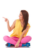 Smiling casual woman showing something Stock Photography