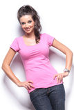 Smiling casual woman standing with hands on hips Stock Image