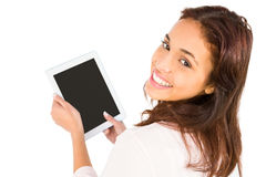 Smiling casual woman using her tablet pc Stock Photo