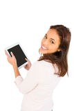 Smiling casual woman using her tablet pc Stock Photography