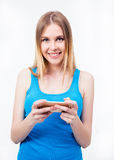 Smiling casual woman using smartphone stock photos