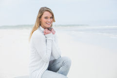 Smiling casual young woman relaxing at beach Stock Image