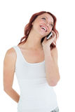 Smiling casual young woman using mobile phone Royalty Free Stock Photo