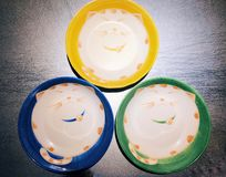 Smiling cat face pattern plates. On the table in a restaurant in Chengdu city Sichuan province China royalty free stock photography