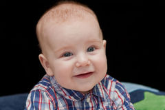 Smiling Caucasian baby boy with blue eyes Royalty Free Stock Photos