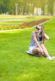 Smiling Caucasian Blond Teenage Girl With Longboard in Green Summer Park Royalty Free Stock Image