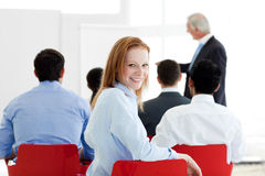 Smiling Caucasian businesswoman at a conference Stock Photo