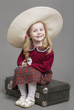 Smiling Caucasian Child Posing in Big Round Sombrero Hat and Sit Stock Photography