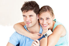 Smiling caucasian couple painting a room. In their new house Stock Image